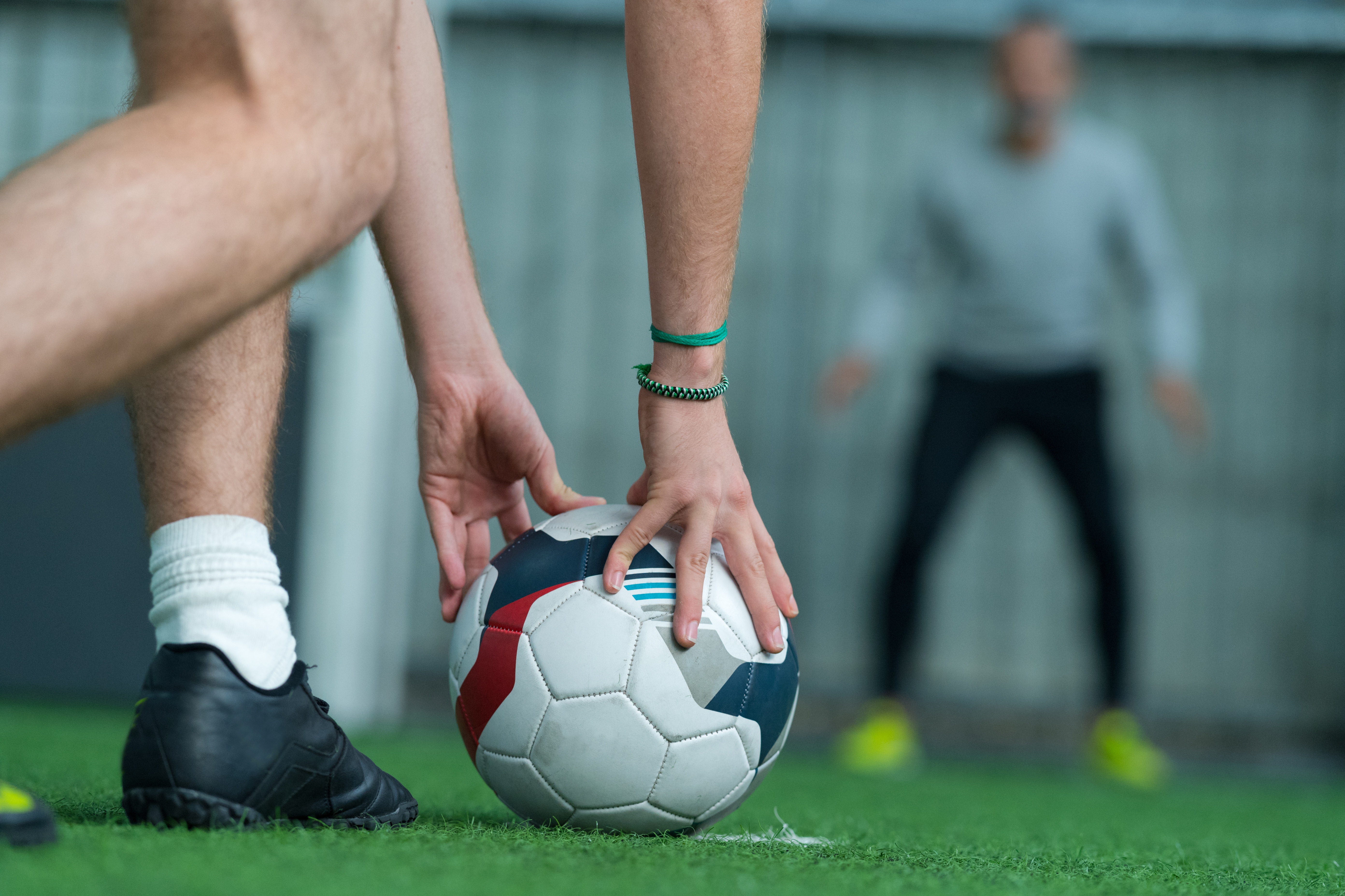 Soccer player placing soccer ball before penalty kick